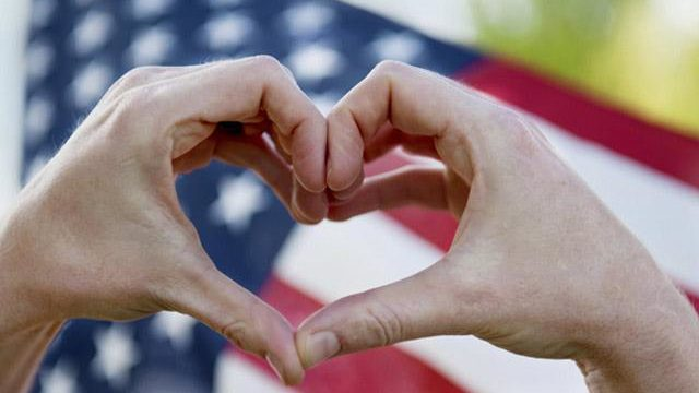 hands making a heart with american flag