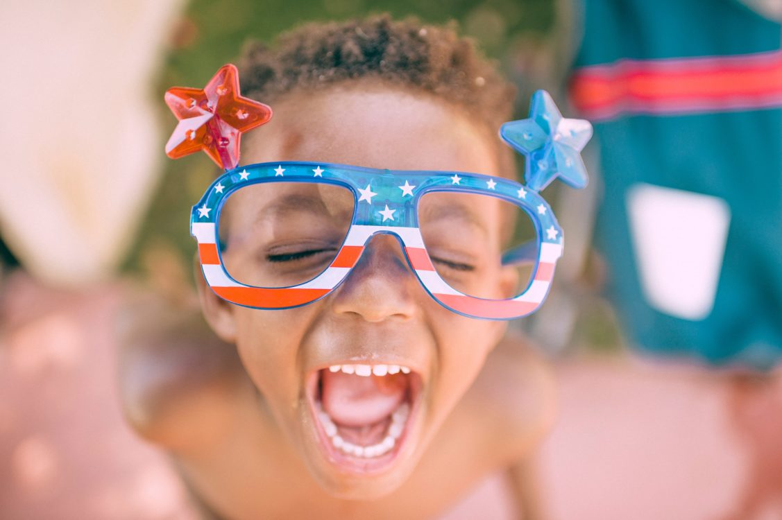 boy wearing american flag glasses