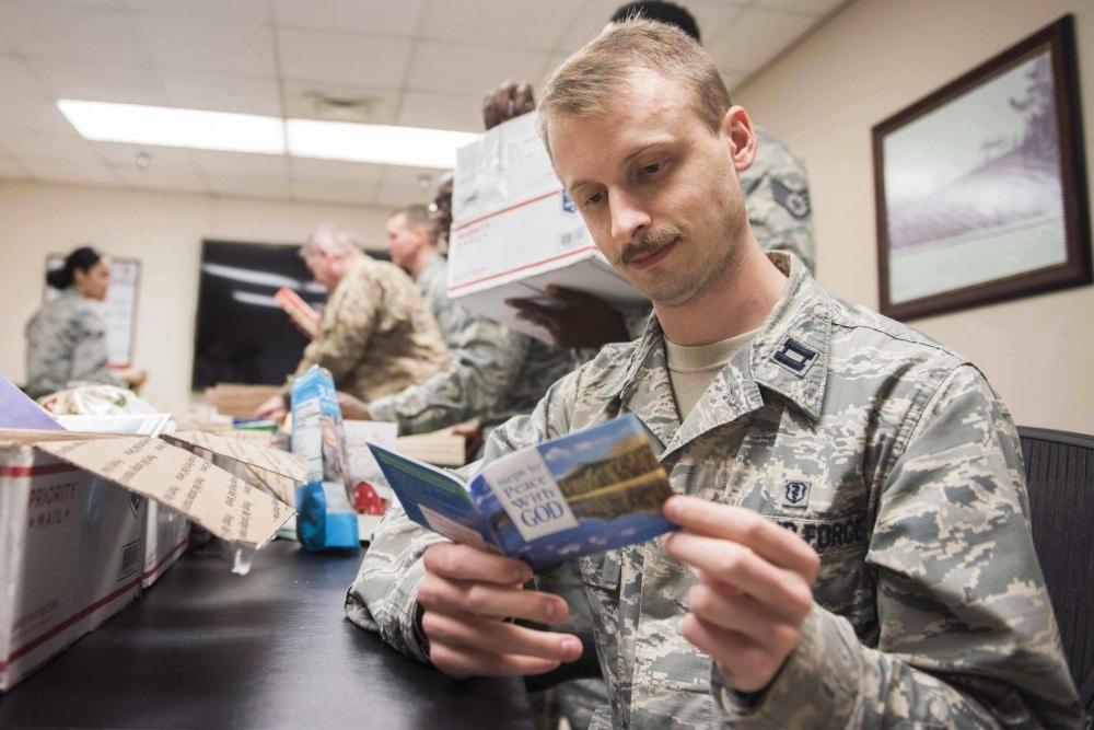 air force capt. reads a booklet from a care package