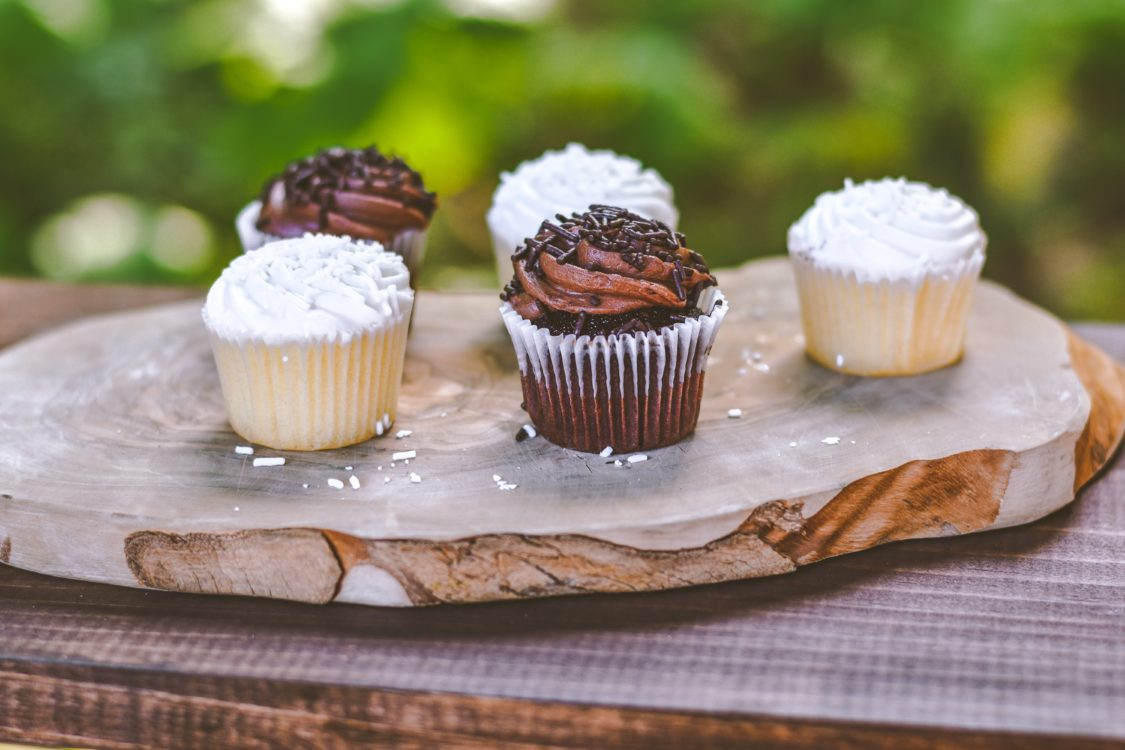 cupcakes on a wood platter
