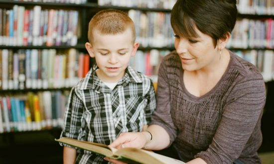 teach at home moment: mom showing son book