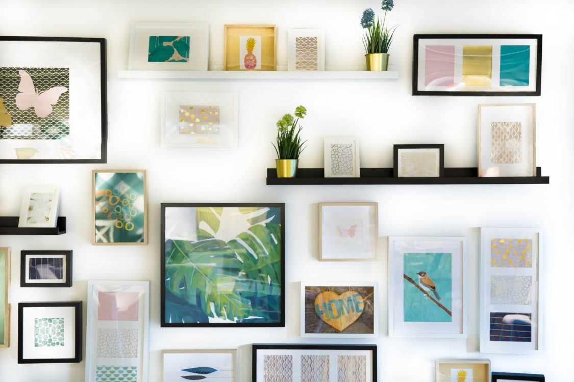 framed pics on a wall